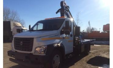 """Эвакуатор ГАЗ-С41R13 """"ГАЗон NEXT"""" с кму PM 12012LA (Италия) и прямой платформой L платформы 5000 мм"""